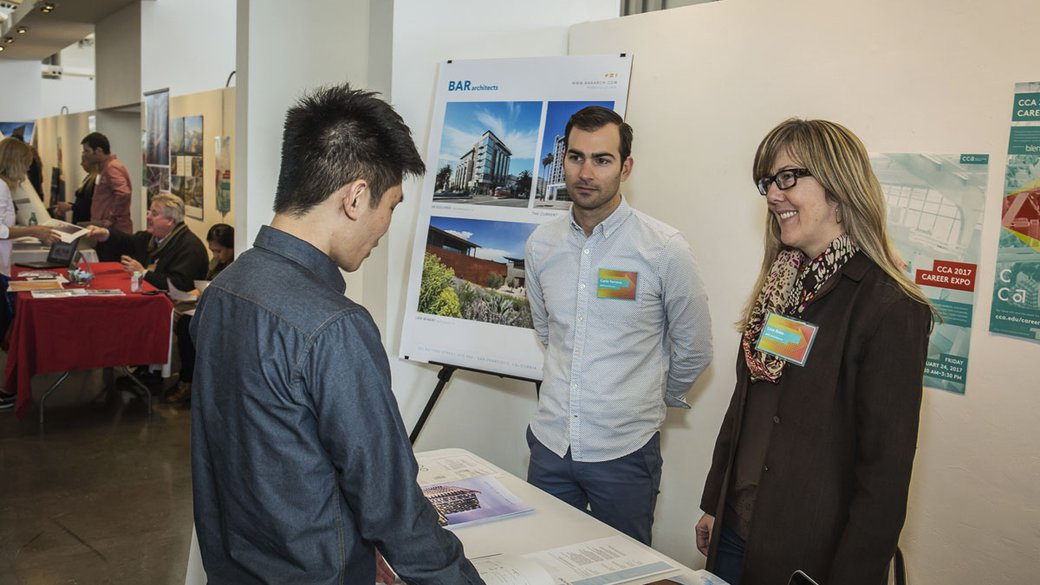 A student talking with associates from BAR Architects