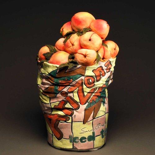 Crop of peaches in ceramics