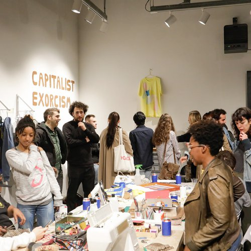 "CCA fine arts students lead a ""Capitalism Exorcism"" activation in the Hubbell Street Galleries"