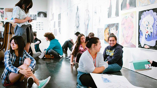 High school students practicing figure drawing during special studio course_special programs feature_MB