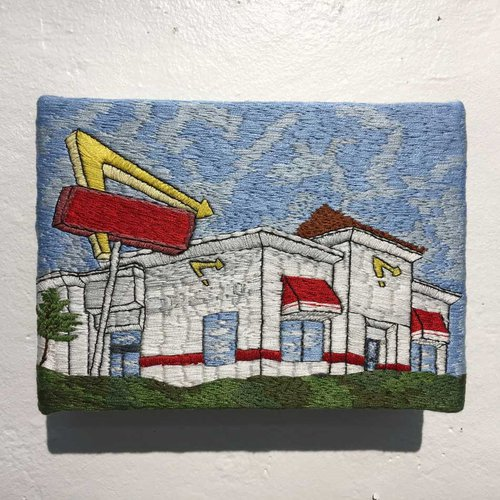 Depiction of fast food restaurant using textiles and embroidery.