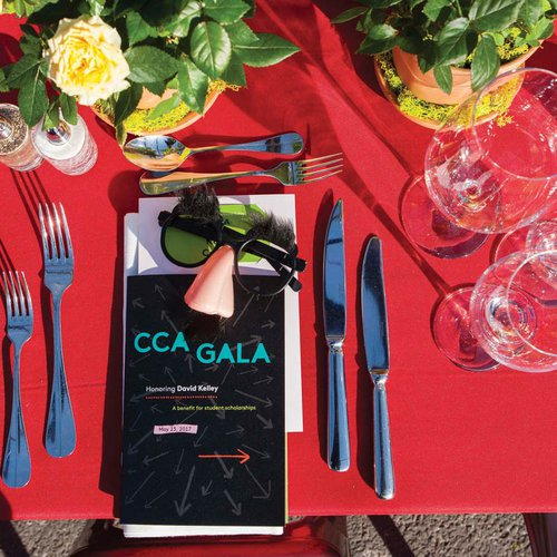 Gala table setting and printed event materials.