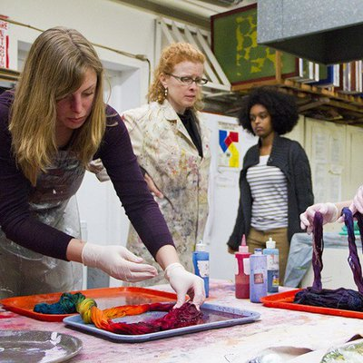 Students dying fabrics in the Dye Lab
