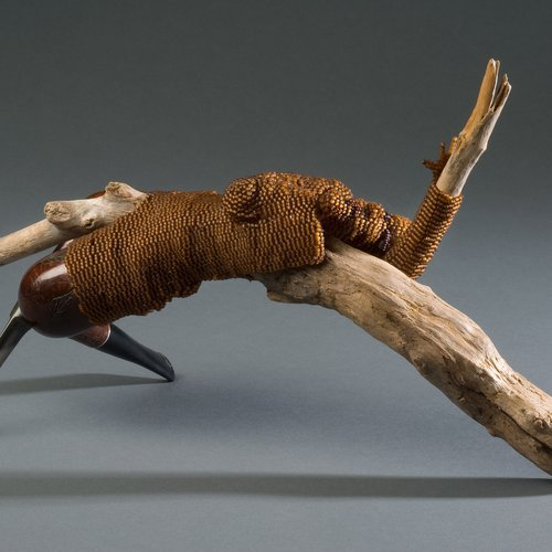 Joyce J. Scott, From the Day After Rape Series: Gatherer of Wood, 2009. Glass beads, thread, pipes, drift wood 7 1/4 x 13 x 3 1/2 inches.