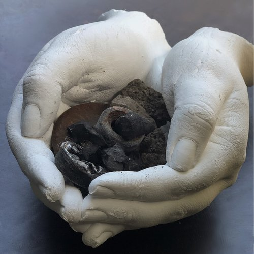 Loulou Evans, The Home I'm Holding: Wildfire victims of the Northern Bay Area hold remnants of their destroyed homes, 2021. Plaster, ash, and dirt.