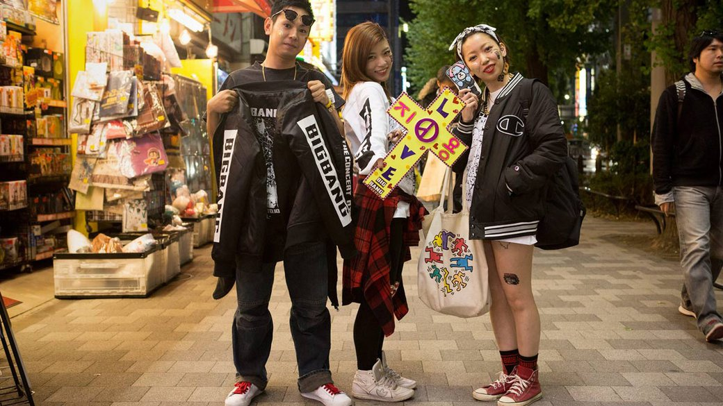 Japanese students pose in the Akihabara district of Tokyo, Japan