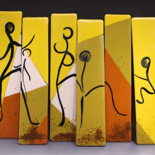 Segments of fused color glass depicting scene of dancing on fire.