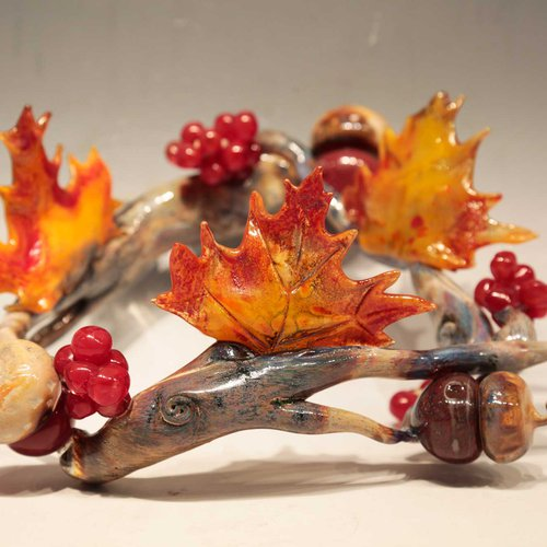 Crown of leaves, branches and fruits in cast glass by Kelsey Kenney.