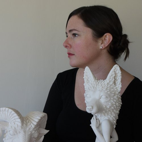 Crystal Morey in her studio with two porcelain sculptures.