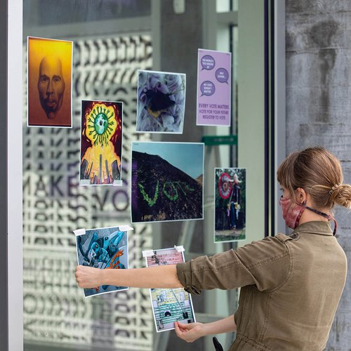 Jaime Austin, director of Exhibitions and Public Programming, curates the window activation at CCA's Hubbell Street Galleries.