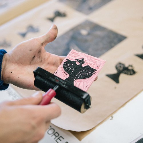 Rollers are a quick way to apply ink to hand-carved woodblocks.