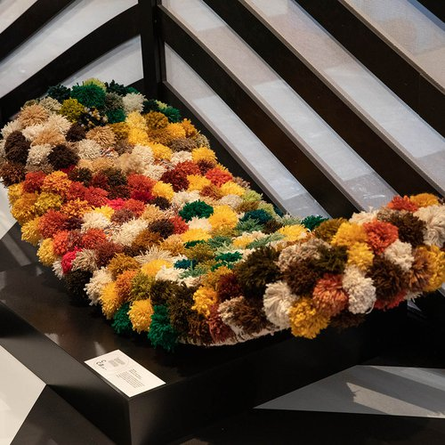 A lounge chair by Jen Lee (BFA Furniture 2020) reused found and donated yarn to create a bed of anemone-like structures to recline on.