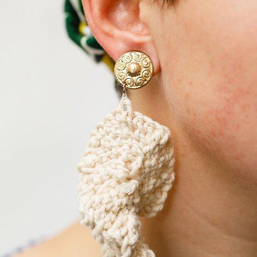 Earrings by Melissa Rodriguez.