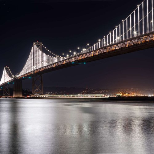 The Bay Bridge connects Oakland and San Francisco—and our two campuses. At night, this landmark is illuminated by Leo Villareal's generative light sculpture Bay Lights.