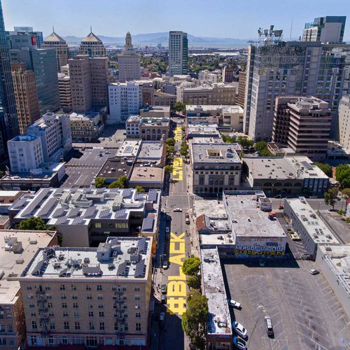 An aerial view of downtown Oakland with the Black Lives Matter street mural across three blocks.