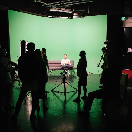 Students film in the Christensen Production Stage, a blank canvas for cinematic creativity.