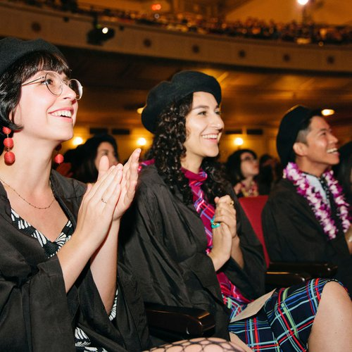 Students cheering for their friends during CCA's 2019 graduation ceremony.