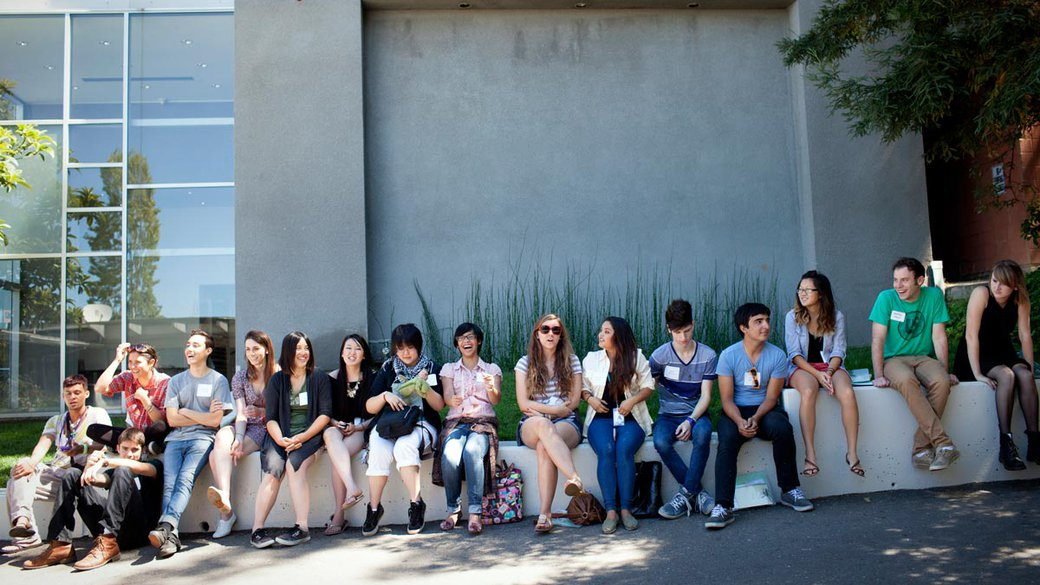 Undergraduate students sitting inside the Oakland campus