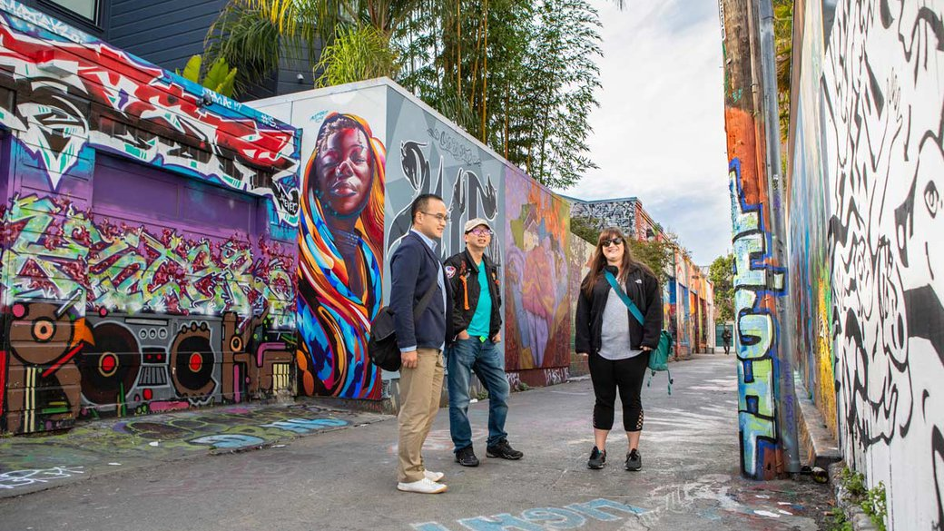 Students standing in Clarion Alley, Mission District's neighborhood for community and student murals