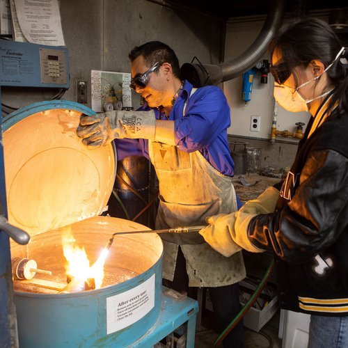 Curtis Arima and student Fran (Fan) Zhang in the Jewelry and Metal Arts studio.
