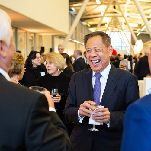 Marv Tseu laughing at the spring 2019 gala.