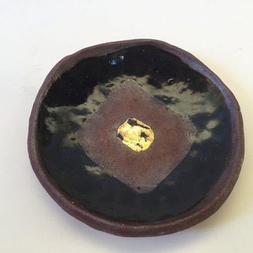 JB Blunk, Untitled - Plate, c. 1985. Ceramic dish, 5 x 0.75 inches. Value: $3,000.