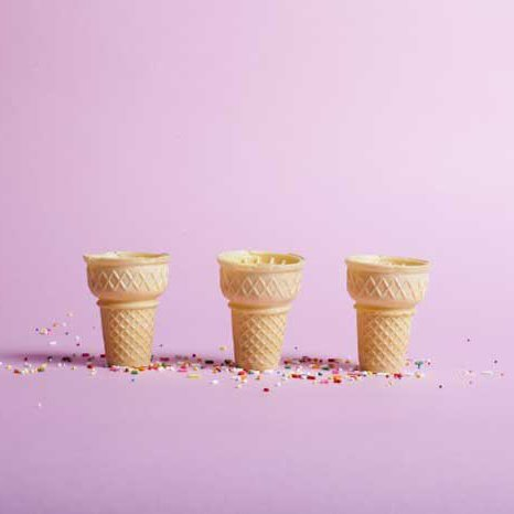 Archival inkjet print of three ice creams cones on a taffy pink background.