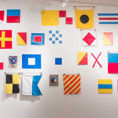 Art with coded message via maritime signal flags.