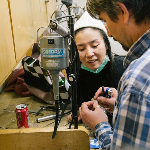Metalworking student gets help from faculty