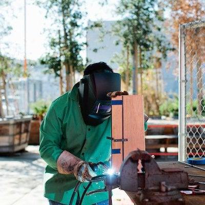 Student welding experience in the metal welding studio