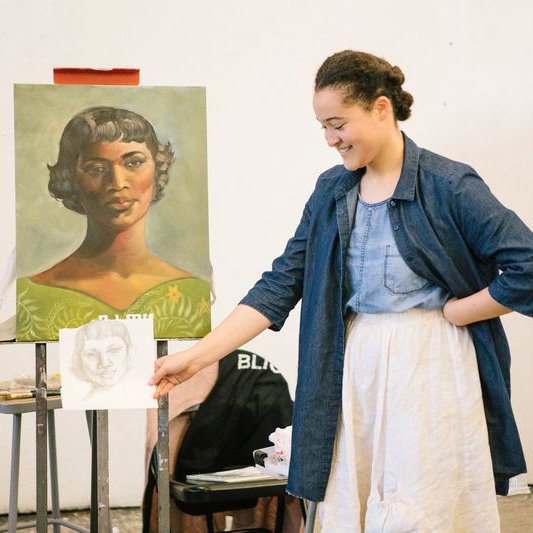 abd93fb5395 Painting and Drawing student holding up a sketch in front of their finished  painting