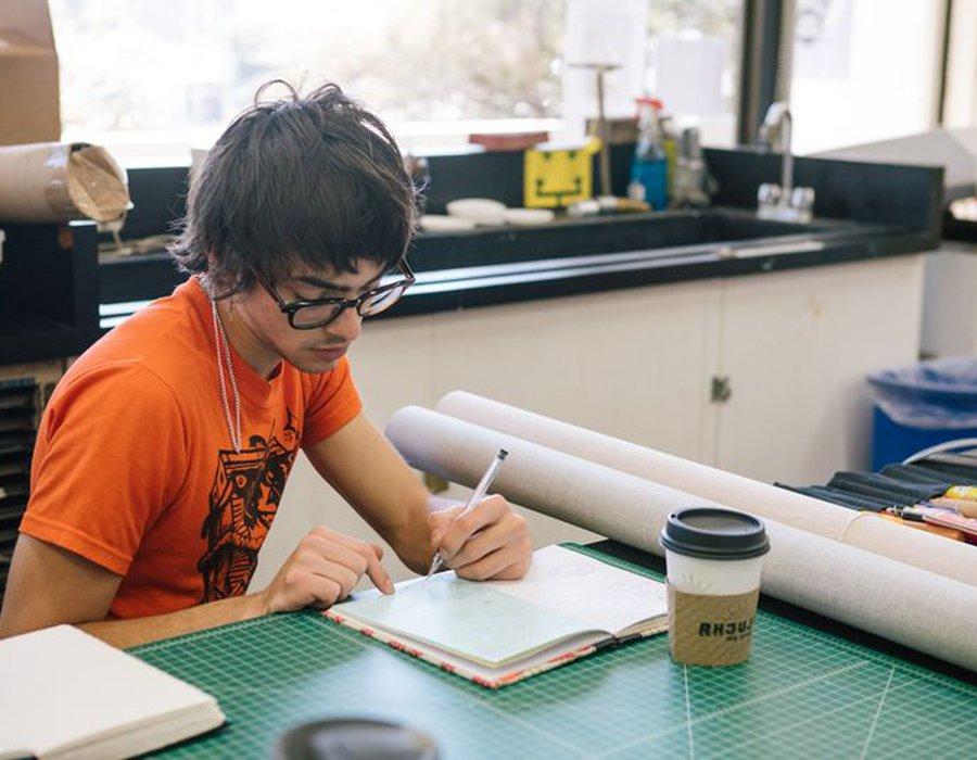 Writing student prepares their materials during their bookbinding class_horizontal feature_MB