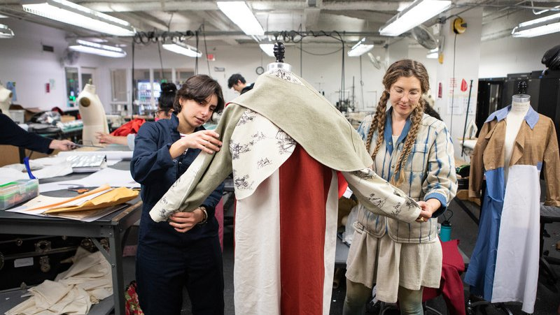 Fashion student adjusts their garment and pattern with the help of faculty_feature_MB