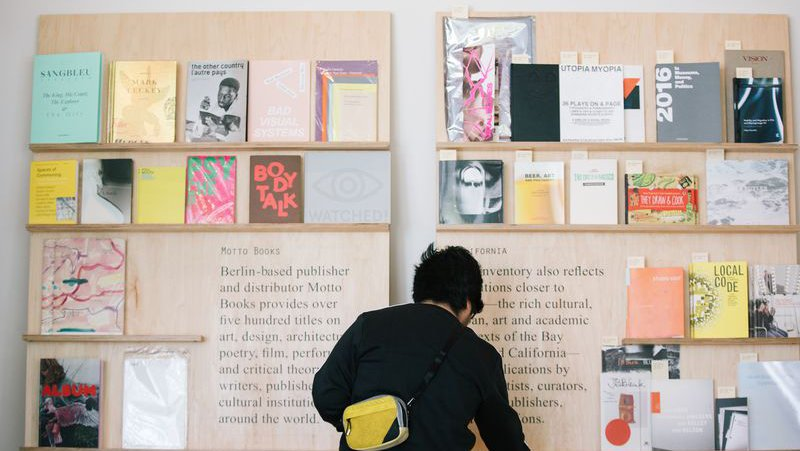 Student selecting a book from the Curatorial Research Bureau_horizontal feature_MB