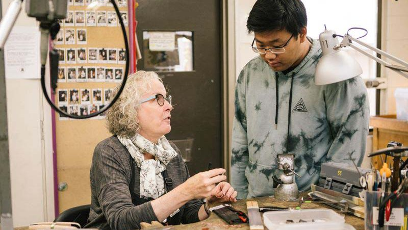 Chair Marilyn da Silva helping Jewelry and Metal Working student