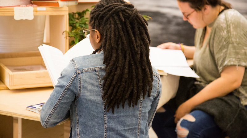 Student reading at the 2018 EOY Exhibition Writing Installation_feature minors_MB