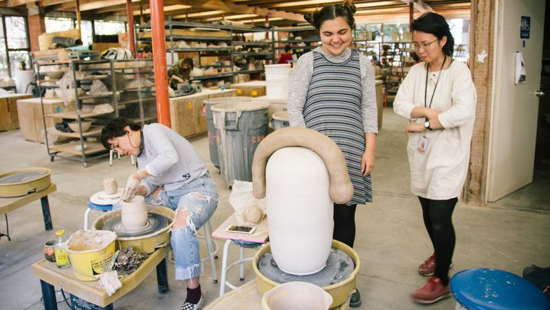 BFA Ceramics professor Cathy Lu consults student on their large scale ceramic sculpture_horizontal image_MB
