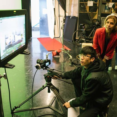 CCA film student shoots on a green screen and reviews footage with faculty